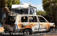 Burnt out LandCruiser and damaged caravan