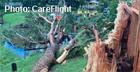 Woman trapped as tree crushes caravan