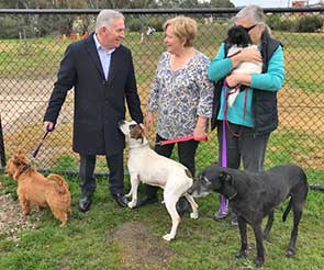 Mr Lucas, Ms Bloomfield (centre) and Albury Wodonga Animal Rescue volunteer Diane with some of the dogs being trained and treated at the rescue centre.