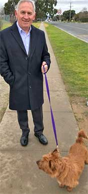 Mr Lucas walking with Rusty, who was handed into the Albury Wodonga Animal Rescue centre.