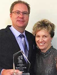 Takalvan owners Dale and Natalie Rethamel with their retailers of the yeara excellence award.