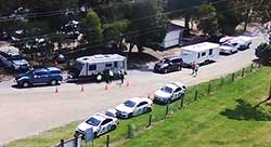 Caravans line up for weight checks at the Princes Hwy's Newmerella rest area