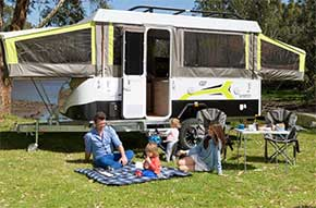Young caravanning family